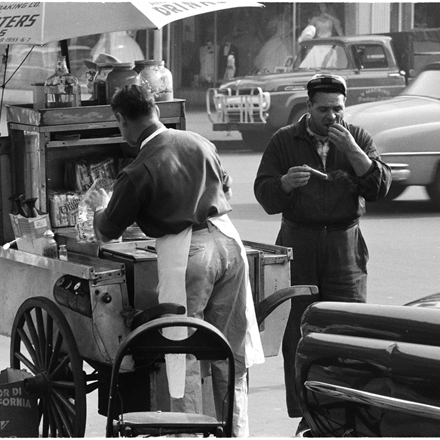 Arthur Rothstein, Look Magazine (1915-1985). Changing New York [Man eating a hot dog], 1957. Museum of the City of New York. X2011.4.7552-57.146D
