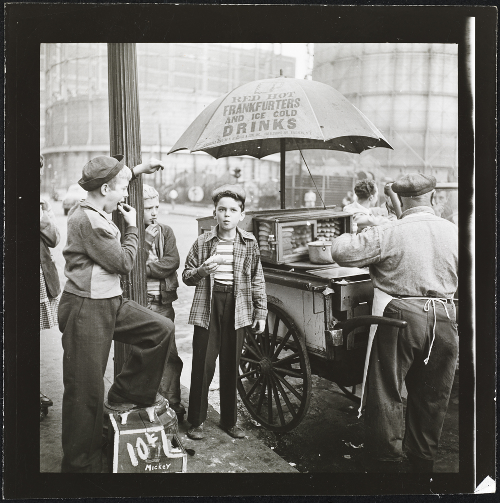 Stanley Kubrick, Look Magazine (1928 – 1999). Shoe Shine Boy [Mickey and other boys at a hotdog cart], 1947. Museum of the City of New York. X2011.4.10368.124