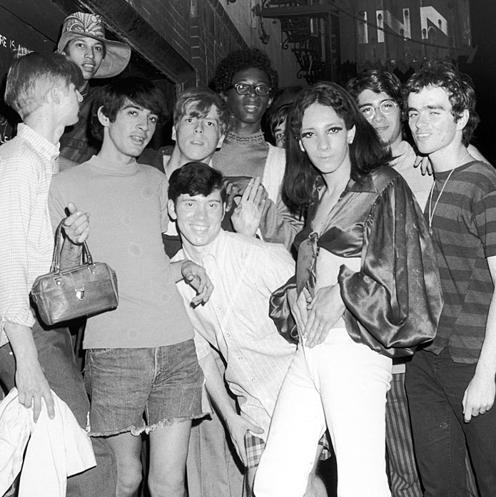 Black and white photograph of a group of young patrons of LGBTQ Bar.