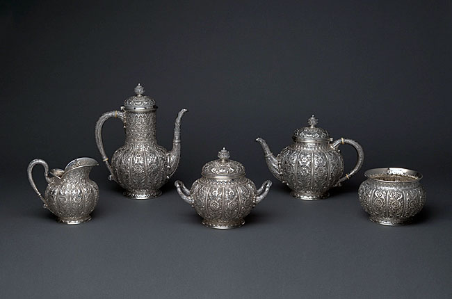 Photograph of a five-piece coffee and tea service by Tiffany and Company.