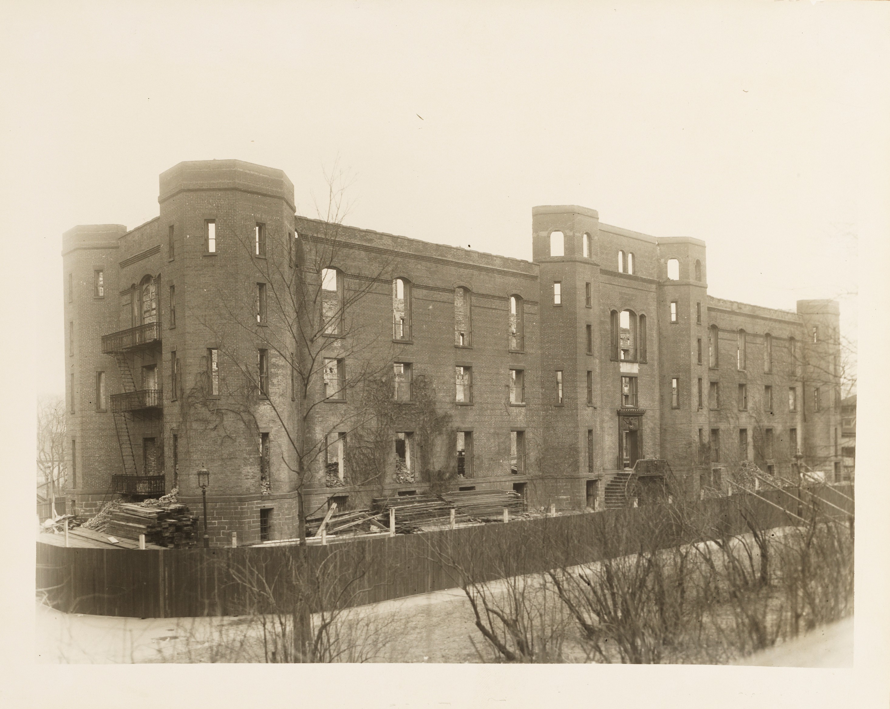 State Arsenal, Central Park, opposite E. 64th Street from the South East and from the North East. | J. Clarence Davies Street Views Scrapbook