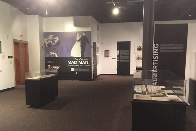 An exhibition installation photograph of The Original Mad Man: Illustrations by Mac Conner.