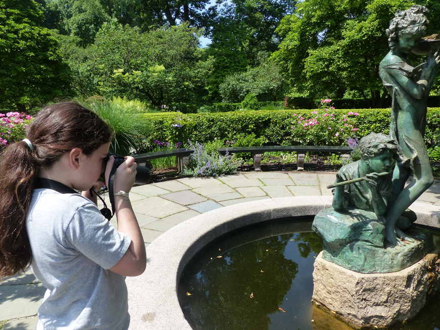 June camper photographing in the Conservatory Garden. Central Park, 2016.
