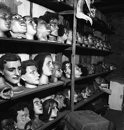 Wax heads sit on shelves in Hattie McKeever's workshop