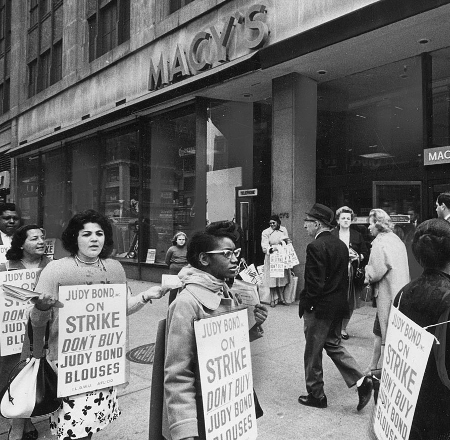 Picketing ILGWU members outside Macy's department store urge shoppers not to buy Judy Bond blouses