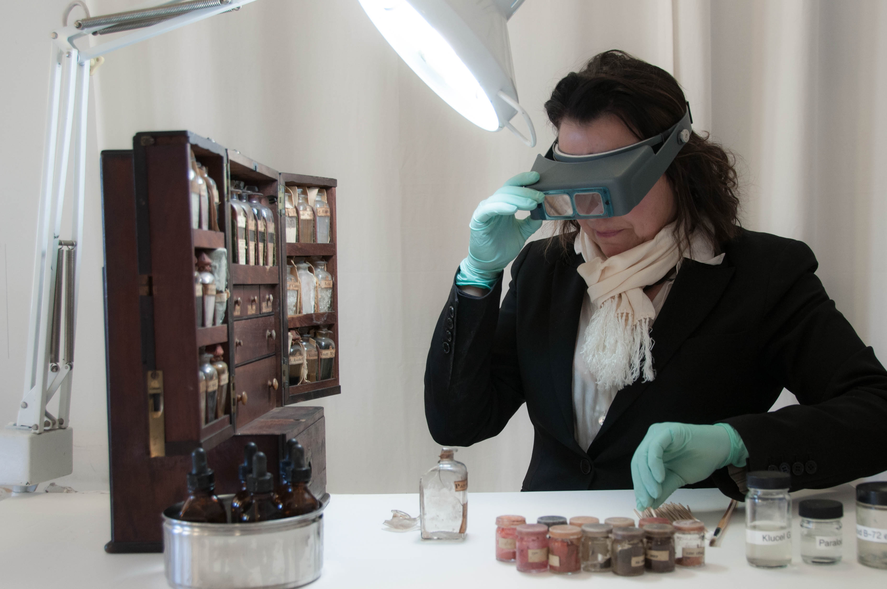 Conservator Linda Nieuwenhuizen at work on the King family medicine dispensary.