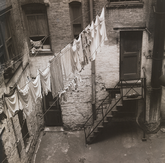 John Albok (1894-1982). John Albok's backyard, view of clothesline strung between windows in brick courtyard, 1392 Madison Ave. ca. 1933. Museum of the City of New York. 82.68.64