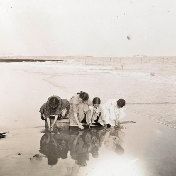 A museum photo by  Jacob A. Riis of kids playing by the water taken in 1895.