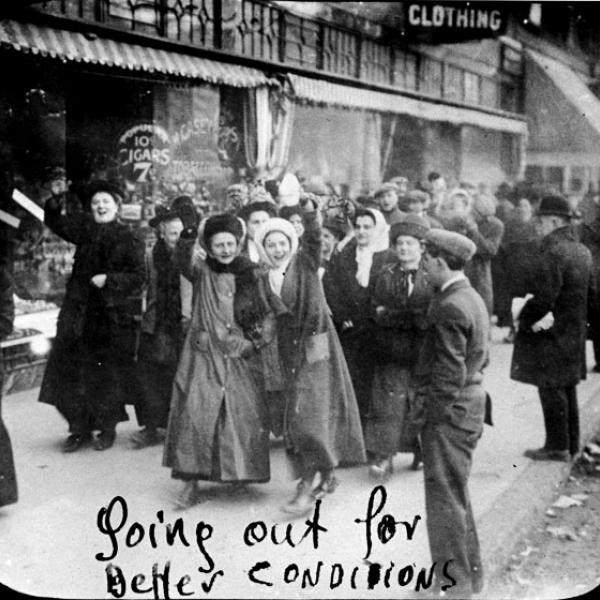 Women garment workers smile for the camera as they go on strike in 1909.