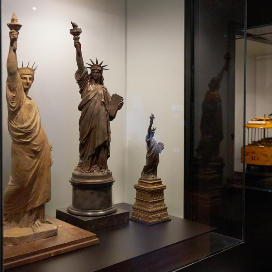 Mock-ups and models of the Statue of Liberty on display in an exhibition