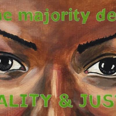 "Painting of a woman's eyes. Painted over her forehead and cheeks are the words ""we the majority demand/EQUALITY & JUSTICE"""