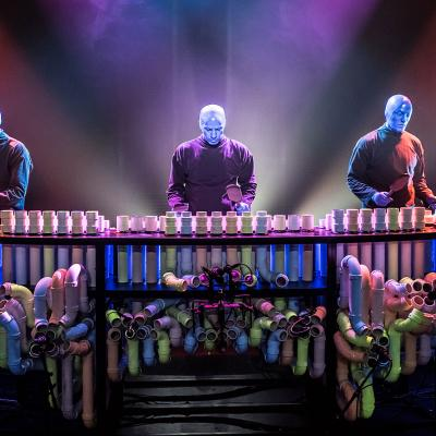 Blue Man Group performing at the pipes