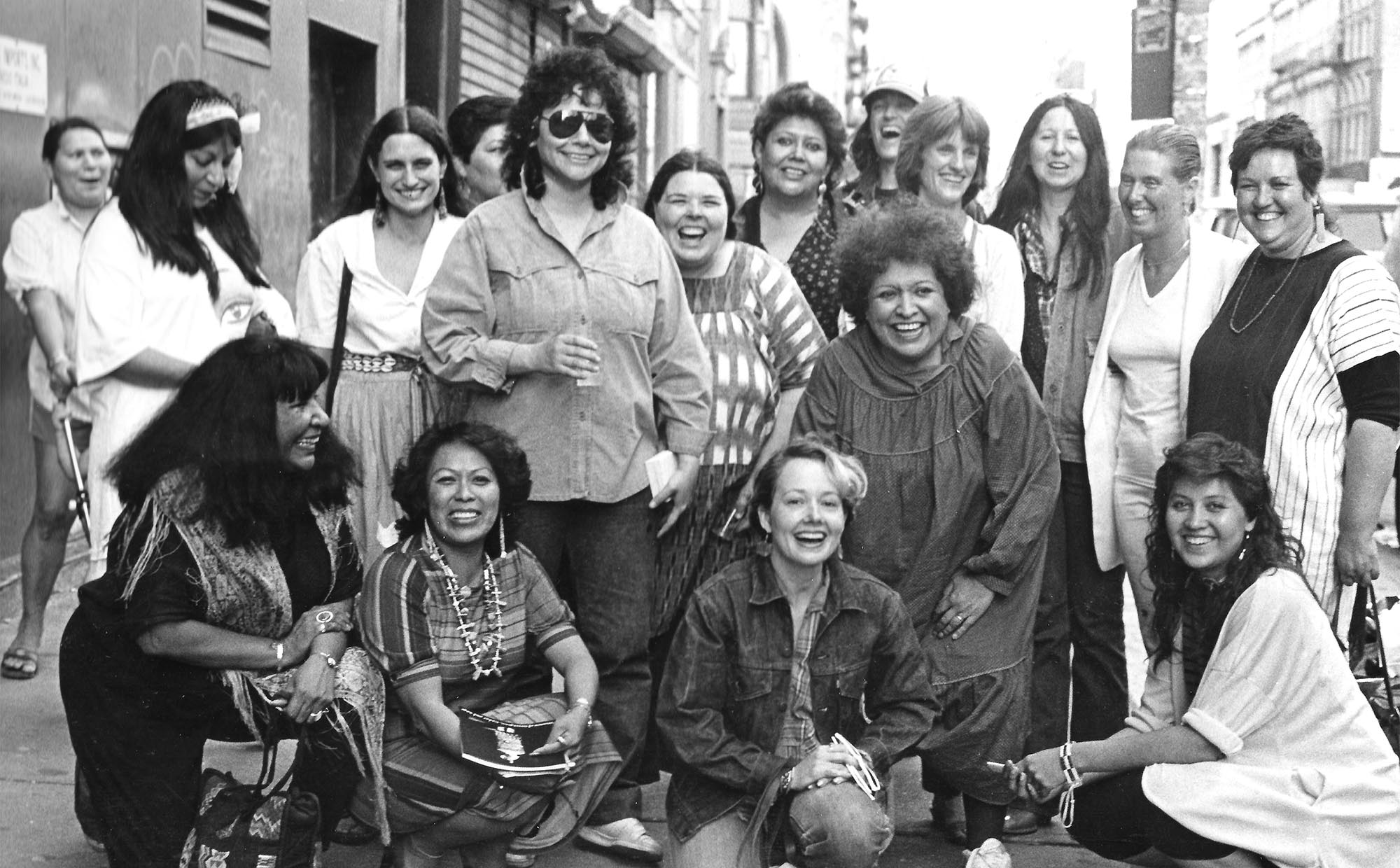 Artists from the exhibition, Women of Sweetgrass, Cedar and Sage, friends and community members outside the American Indian Community House Gallery, 1985. Photo by Jesse Cooday.