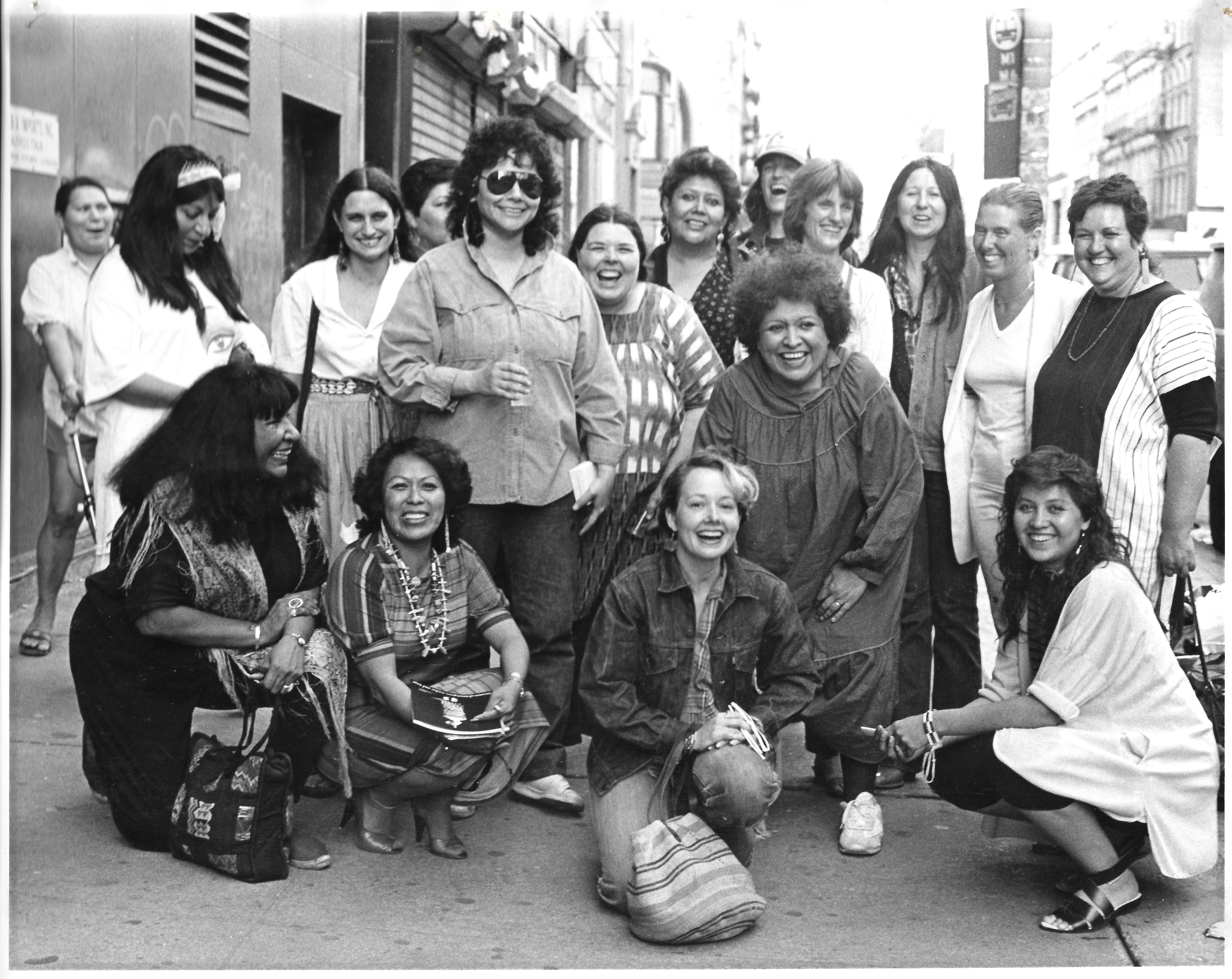 1)Artists from the exhibition, Women of Sweetgrass, Cedar and Sage, friends and community members outside the American Indian Community House Gallery, 1985.