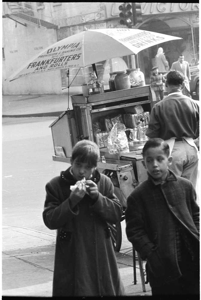 Arthur Rothstein, Look Magazine (1915-1985). Changing New York [Girl eating a hot dog], 1957. Museum of the City of New York. X2011.4.7552-57.146C