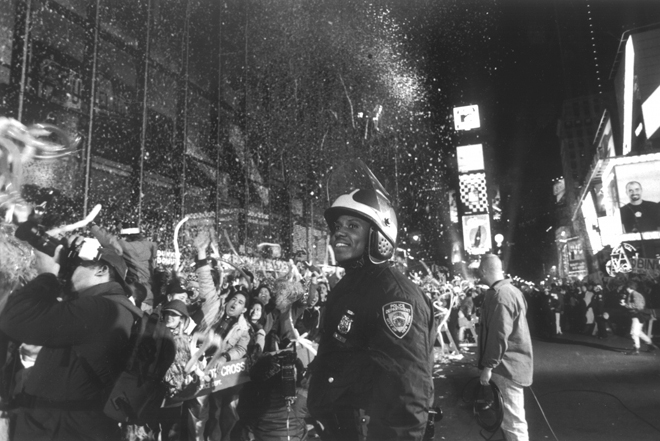 "Steffen A. Kaplan (no dates). Police officer and crowd at (11:59) – 12am – N. Year's Eve ""1997"", 1996-1997. Museum of the City of New York. 2001.3.5"