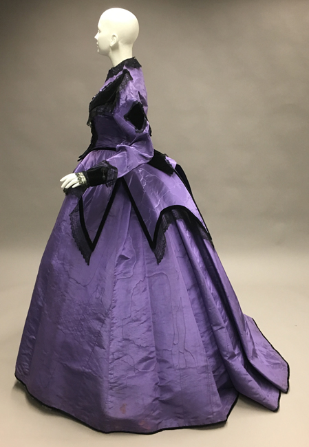 Side view of ca. 1866 dress. 41.35.105A-C.