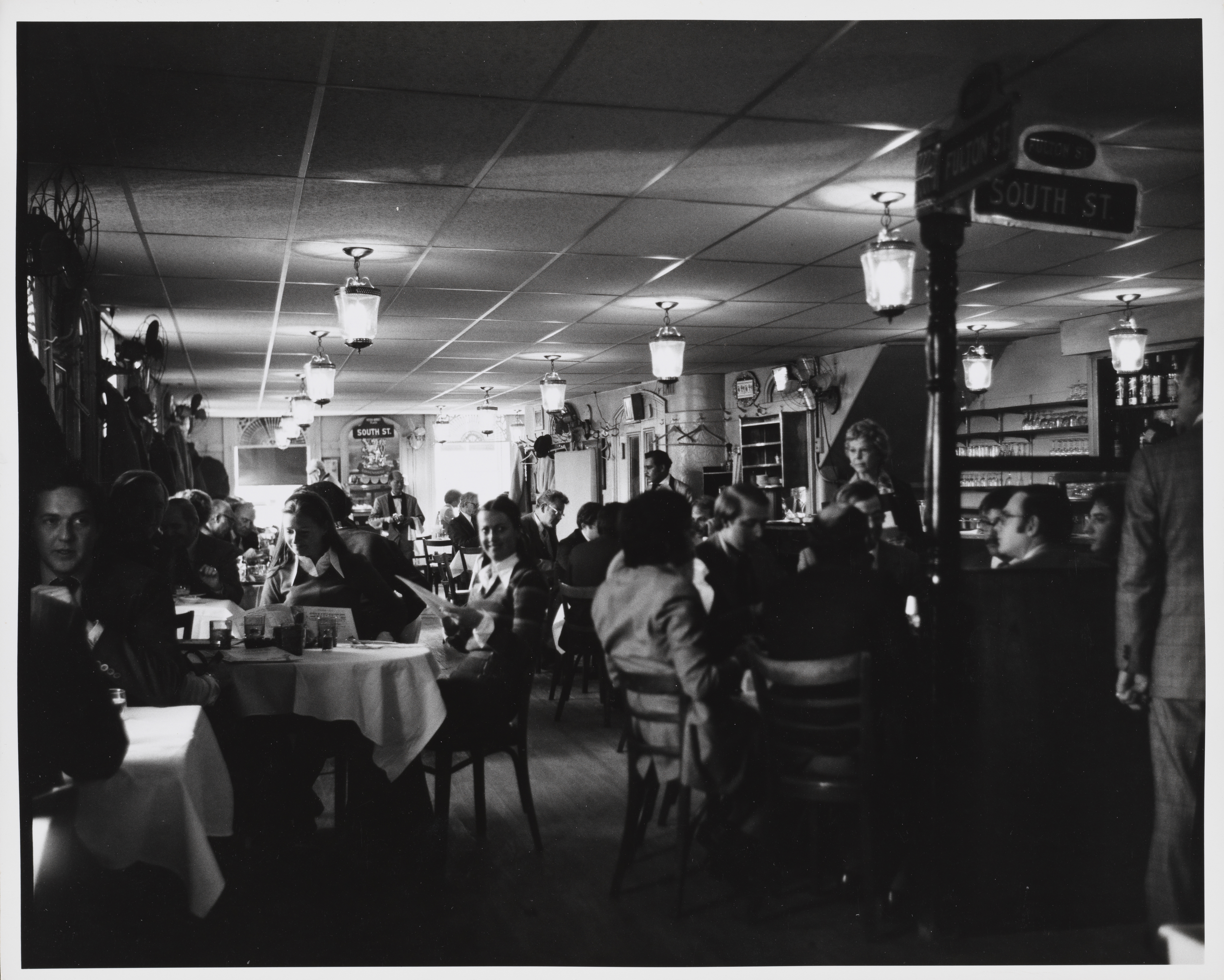 Edmund Vincent Gillon. [Interior of Sweet's Restaurant, 2 Fulton Street.] ca. 1977. Museum of the City of New York. 2013.3.1.315