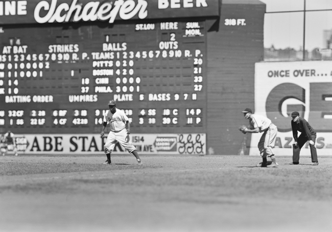 Jackie Robinson runs bases during a game at Ebbets Field with the Brooklyn Dodgers