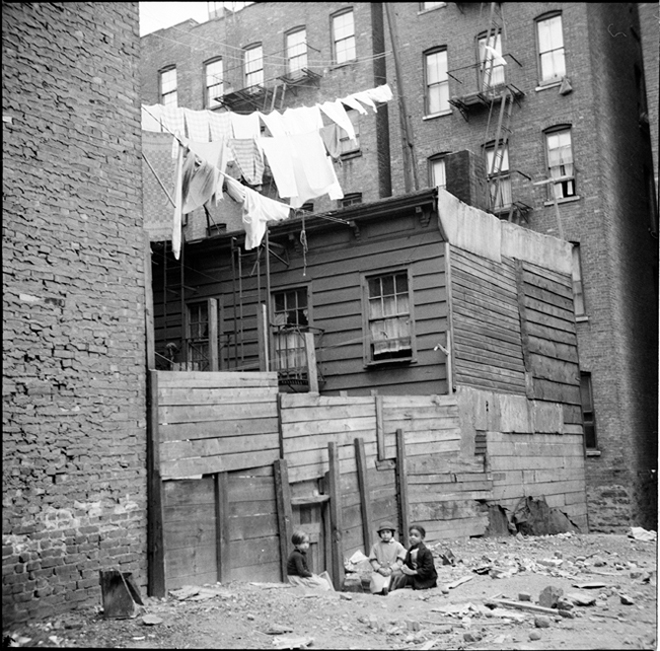 Arnold Eagle, Wooden Rear Tenements–Children Playing in Dirt. 1935. Museum of the City of New York. 43.131.11.310