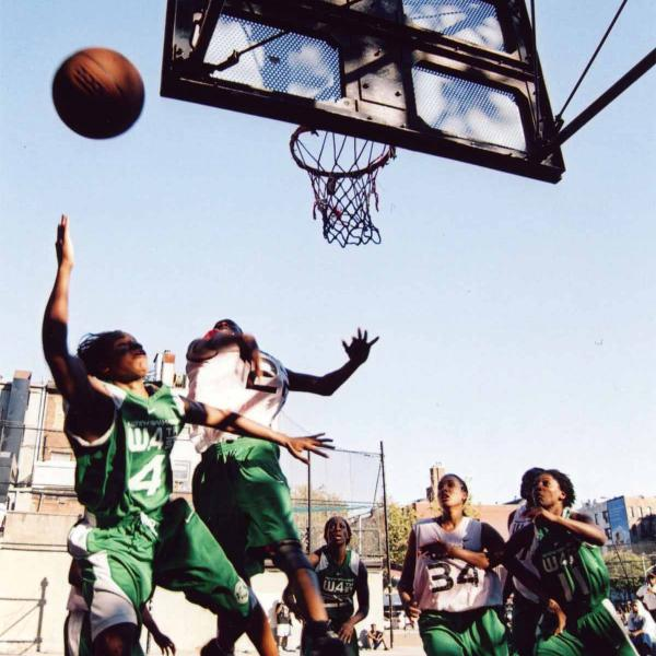 This photograph by Bobbito Garcia shows Bianca Brown #4 and Monique Coker #34 playing a tournament at West 4th Street circa 2003.