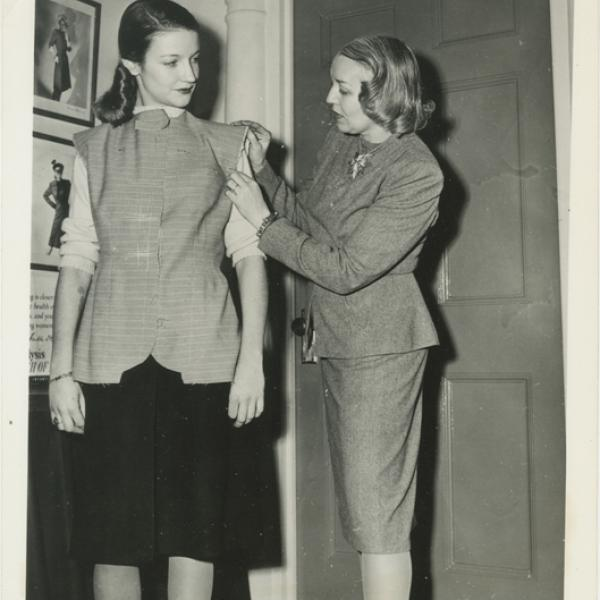 """A photo of Vera Maxwell fitting a model for Museum of the City of New work's """"A Salute to Vera Maxwell"""" back in 1942."""