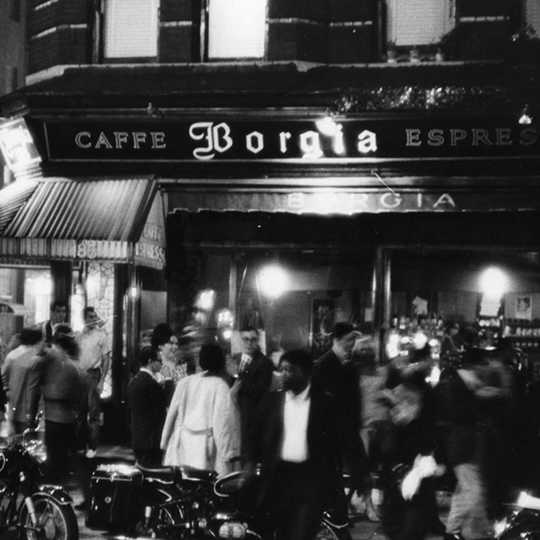 Photograph by Fred W. McDarrah of a motion-filled crowd outside the Caffe Borgia in Greenwich Village